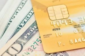 Credit card with money, Image courtesy of sixninepixels at FreeDigitalPhotos.net